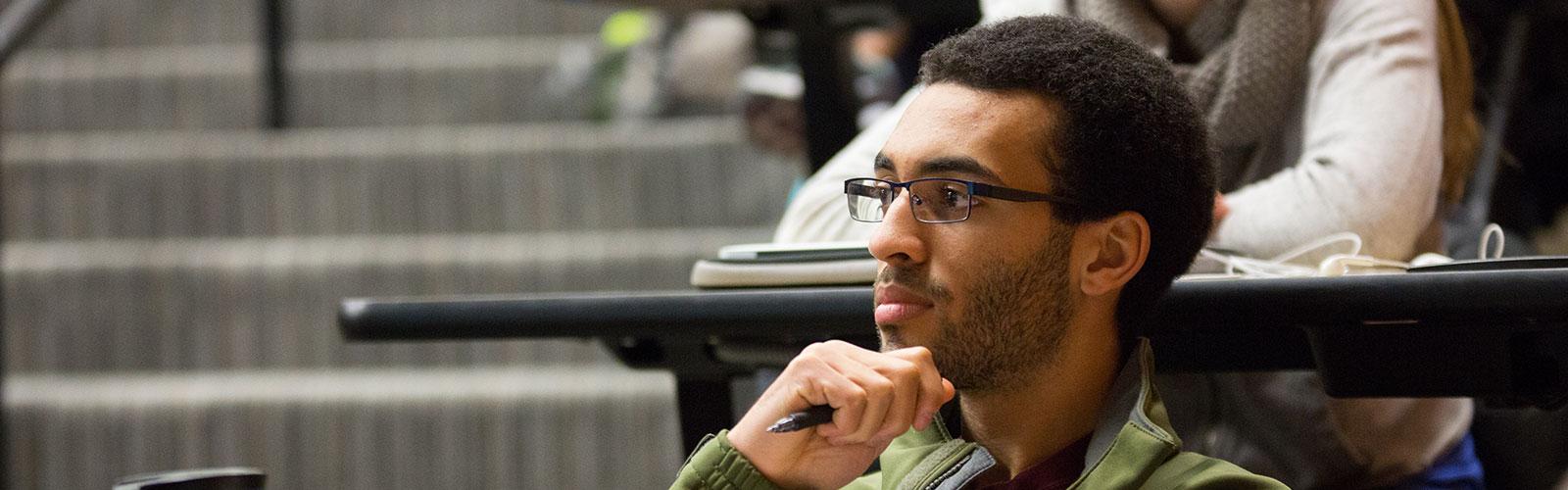 Medical student listening in Dr. Kavan