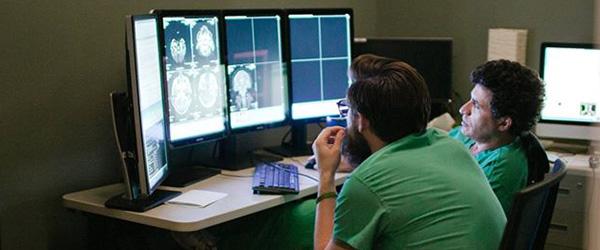 Neuroradiology residents on computer