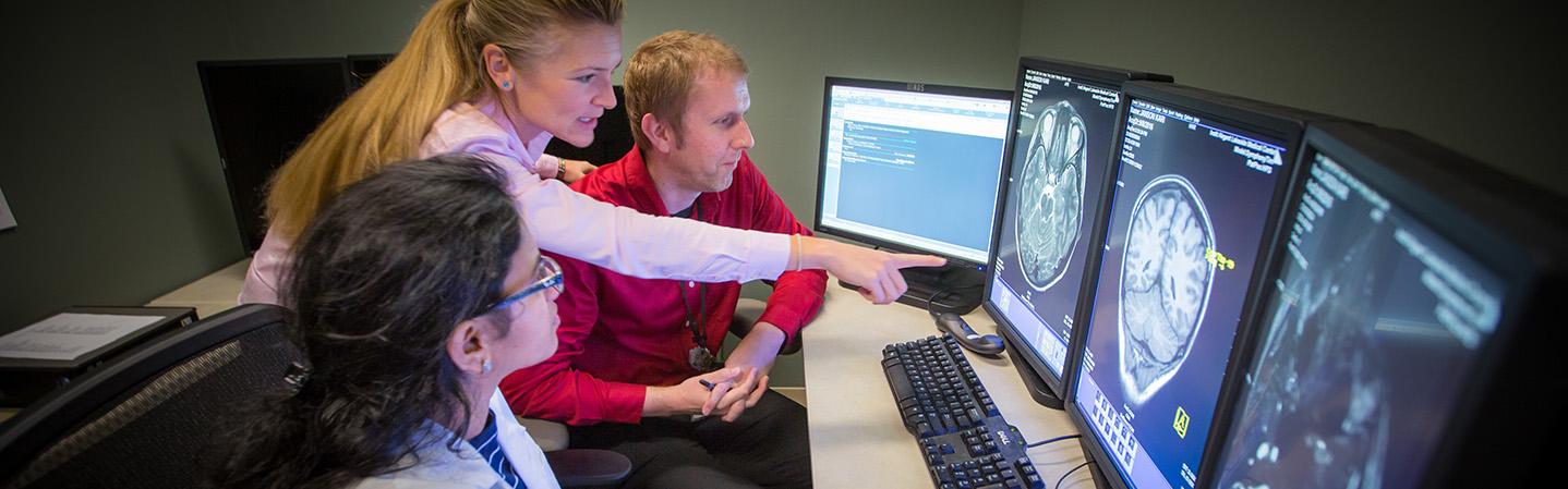 Radiology residents looking at screen