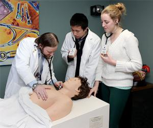 CESC faculty physician with students and demo model