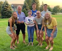 Dan McGuire, MD'82, with his fellow Creighton students at the Des Moines send-off event. Nearly 40 years after he graduated from the School of Medicine, McGuire is taking care of some unfinished business: his undergrad degree.